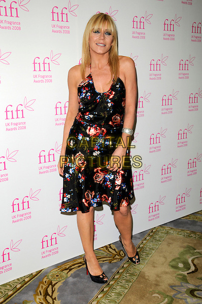 MICHELLE COLLINS.The FIFI UK Fragrance Awards 2008 at the Dorchester Hotel, Park Lane, London, England..April 23rd 2008.full length black red floral print patterned dress shoes roses peep to.CAP/CAN.©Can Nguyen/Capital Pictures.