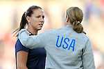 20 August 2014: Lauren Holiday (USA) (left) talks head coach Jill Ellis (right). The United States Women's National Team played the Switzerland Women's National Team at WakeMed Stadium in Cary, North Carolina in an women's international friendly soccer game. The United States won the match 4-1.