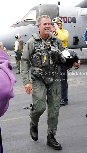 "United States President George W. Bush passes through the ""side boys"" after a successful trap aboard the USS Abraham Lincoln (CVN 72) in a S-3B Viking assigned to the Blue Wolves of Sea Control Squadron Three Five (VS-35) designated ""NAVY 1"" on May 1, 2003.   President Bush is the first sitting President to trap aboard an aircraft carrier at sea. The President is conducting a visit aboard ship to meet with the Sailors and will address the Nation as Lincoln prepares to return from a 10-month deployment to the Arabian Gulf in support of Operation Iraqi Freedom. <br /> Credit: United States Navy via CNP"