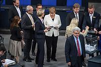 19. Sitzung des Deutschen Bundestag am Mittwoch den 14. Maerz 2018.<br /> Erster Tagesordnungspunkt war die Wahl von Angela Merkel zur Bundeskanzlerin.<br /> Im Bild: Angela Merkel (mit weissem Blouson) bei der Stimmabgabe.<br /> 14.3.2018, Berlin<br /> Copyright: Christian-Ditsch.de<br /> [Inhaltsveraendernde Manipulation des Fotos nur nach ausdruecklicher Genehmigung des Fotografen. Vereinbarungen ueber Abtretung von Persoenlichkeitsrechten/Model Release der abgebildeten Person/Personen liegen nicht vor. NO MODEL RELEASE! Nur fuer Redaktionelle Zwecke. Don't publish without copyright Christian-Ditsch.de, Veroeffentlichung nur mit Fotografennennung, sowie gegen Honorar, MwSt. und Beleg. Konto: I N G - D i B a, IBAN DE58500105175400192269, BIC INGDDEFFXXX, Kontakt: post@christian-ditsch.de<br /> Bei der Bearbeitung der Dateiinformationen darf die Urheberkennzeichnung in den EXIF- und  IPTC-Daten nicht entfernt werden, diese sind in digitalen Medien nach §95c UrhG rechtlich geschuetzt. Der Urhebervermerk wird gemaess §13 UrhG verlangt.]