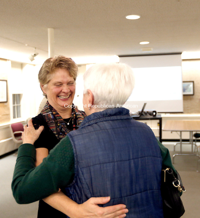 Woodbury, CT- 17 November 2016-111716CM05- Sue Piel, is congratulated by Leslie Lebl director of the Woodbury Public Library Board of Trustees during a reception at the library on Thursday. Piel who has worked there for more than 20 years, has been named the new director at the library.     Christopher Massa Republican-American