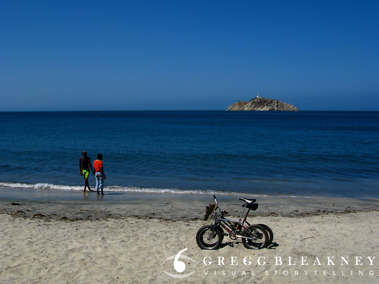 Young kids at the beach with their bicycles - Santa Marta - Colombia
