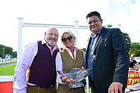 Connections of Beepeecee receive their trophy for winning The Molson Coors Handicap  during Afternoon Racing at Salisbury Racecourse on 13th June 2017