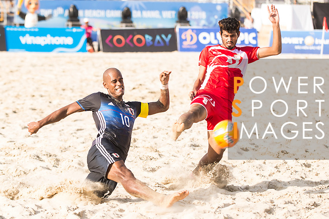 MOREIRA Ozu of Japan fights for the ball with AL ZADJALI Nooh Salim Abdullah of Oman  during the Beach Soccer Men's Team Gold Medal Match between Japan and Oman on Day Nine of the 5th Asian Beach Games 2016 at Bien Dong Park on 02 October 2016, in Danang, Vietnam. Photo by Marcio Machado / Power Sport Images