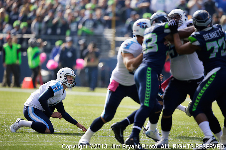 Tennessee Titians holder Brett Kern (6) watches Rob Bironas 38-yard field goal against the Seattle Seahawks at CenturyLink Field in Seattle, Washington on October 13, 2013. The Seattle Seahawks beat the Titians  20-13.   ©2013. Jim Bryant Photo. All Rights Reserved.
