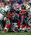 2 November 2008:  Buffalo Bills' running back Marshawn Lynch (23) breaks through the defensive line during a game against the New York Jets at Ralph Wilson Stadium in Orchard Park, NY. The Jets defeated the Bills 26-17 improving their record to 5 and 3 for the season...Mandatory Photo Credit: Ed Wolfstein Photo
