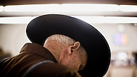 A man wearing a cowboy's ten gallon hat attends a cattle auction in Dodge City, Kansas.