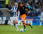 Aaron Mooy of Huddersfield Town  in action with Adam Reach of Sheffield Wednesday during the English Championship play-off 1st leg match at the John Smiths Stadium, Huddersfield. Picture date: May 13th 2017. Pic credit should read: Simon Bellis/Sportimage