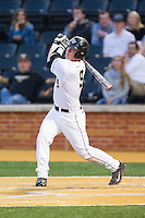 Ben Breazeale (9) of the Wake Forest Demon Deacons follows through on his swing against the Maryland Terrapins at Wake Forest Baseball Park on April 4, 2014 in Winston-Salem, North Carolina.  The Demon Deacons defeated the Terrapins 6-4.  (Brian Westerholt/Four Seam Images)