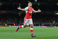 Alexis Sanchez of Arsenal (right) celebrates scoring the opening goal of the game during the UEFA Champions League match between Arsenal and PFC Ludogorets Razgrad at the Emirates Stadium, London, England on 19 October 2016. Photo by David Horn / PRiME Media Images.