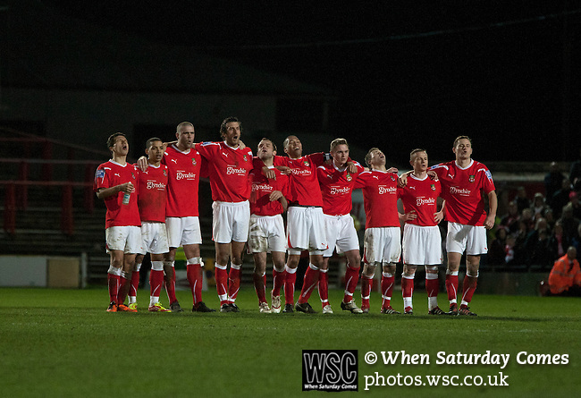 Wrexham 1 Brighton & Hove Albion 1, 18/01/2012. Racecourse Ground, FA Cup 3rd Round Replay. Wrexham players showing their emotion during the penalty shoot out against Brighton and Hove Albion in an FA Cup third round replay, at the Racecourse Ground played following the teams one-all draw in the first match. The replay was won by Brighton, 5-4 on penalty kicks after the match had ended in a one-all draw after extra time, watch by a crowd of 8316. The visitors played in the Championship, three leagues above their rivals from Wales, who were top of the Conference at the time of the match. Photo by Colin McPherson.