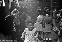 Anna Scher in head band.  Anna Scher Children's Theatre, East End of London 1972.  Kids would come after school and be expected to work hard.  Here, they're doing some filming for the BBC.  Some went on to have careers in the industry and a few became household names: Pauline Quirk, Phil Daniels.