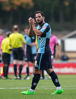 Sam Wood of Wycombe Wanderers applauds the supporters on his return from injury during the Sky Bet League 2 match between Wycombe Wanderers and Northampton Town at Adams Park, High Wycombe, England on 3 October 2015. Photo by Andy Rowland.