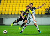 Mark Milligan (right) fouls Wellington's Goran Paracki during the A-League football match between Wellington Phoenix and Melbourne Victory at Westpac Stadium in Wellington, New Zealand on Friday, 10 January 2018. Photo: Dave Lintott / lintottphoto.co.nz