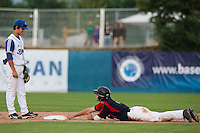25 july 2010: Petr Baroch of Czech Republic dives safely into second base as Maxime Lefevre watches during France 6-1 victory over Czech Republic, in day 3 of the 2010 European Championship Seniors, in Neuenburg, Germany.