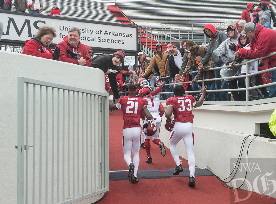 NWA Democrat-Gazette/BEN GOFF @NWABENGOFF<br /> Players celebrate Saturday, April 7, 2018, after the Arkansas Red versus White Game at War Memorial Stadium in Little Rock.