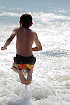 A young boy plays on the beach in California at the beginning of summer