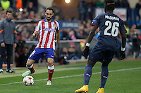 Atletico de Madrid´s Juanfran (L) and Olympiacos´s Masuaku during Champions League soccer match between Atletico de Madrid and Olympiacos at Vicente Calderon stadium in Madrid, Spain. November 26, 2014. (ALTERPHOTOS/Victor Blanco) /NortePhoto