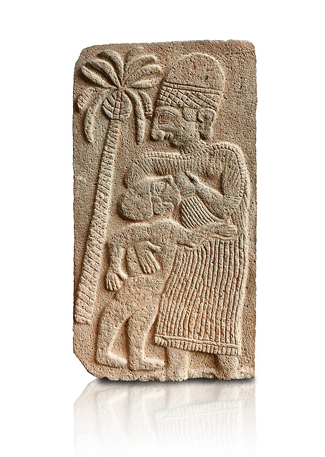 Pictures & images of the North Gate Hittite sculpture stele depicting a women breast feeding a child. 8the century BC.  Karatepe Aslantas Open-Air Museum (Karatepe-Aslantaş Açık Hava Müzesi), Osmaniye Province, Turkey. Against white background