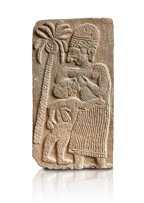 Pictures & images of the North Gate Hittite sculpture stele depicting a women breast feeding a child. 8the century BC.  Karatepe Aslantas Open-Air Museum (Karatepe-Aslantaş Açık Hava Müzesi), Osmaniye Province, Turkey. Against white background