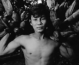 PERU, Amazon Rainforest, South America, Latin America, portrait of a young man carrying bananas (B&W)