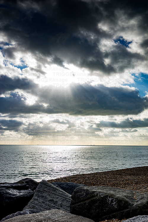 Stormy skies over the seafront in Hythe, Kent, England with dramatic sunset