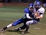 Damonte Ranch Mustangs Samuel Banghart is hit by Carson Senators Nolan Shine during their football game played on Friday night, October 4, 2013 at Carson High School.