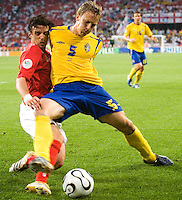 Owen Hargreaves (16) of England in action against Erik Edman (5) of Sweden. England and Sweden played to a 2-2 tie in their FIFA World Cup Group B match at  FIFA World Cup Stadium, Cologne, Germany, June 20, 2006.