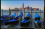 Italy, Venice.  Think Lines!<br /> A combination of vertical, horizontal and diagonal lines. The diffuse, hazy sunlight produced soft shadows in the distance. Venice's vaporettos might be its best photographic asset. <br /> Gondolas and a vaporetto (water taxi) on the Grand Canal, Venice, Italy.