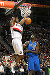 04/03/11--Blazers' LaMarcus Aldridge dunks the basketball over Mavericks' Brendan Haywood at the Rose Garden in Portland, Or.. Portland defeated Dallas 104-96..Photo by Jaime Valdez........................................