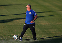 Brazil head coach Luiz Felipe Scolari controls the ball during training ahead of tomorrow's World Cup quarter final vs Colombia tomorrow