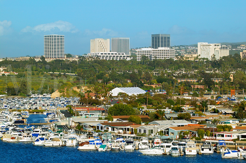 Boats in Newport Harbor, Fashion Island in the distance, Newport Beach, California.