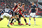 Lee Evans of Sheffield Utd is brought down by a Millwall leg during the championship match at the Bramall Lane Stadium, Sheffield. Picture date 14th April 2018. Picture credit should read: Simon Bellis/Sportimage