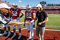 STANFORD, CA - SEPTEMBER 21: Honorary Captain Katie Ledecky receives the game coin from Referee Michael Mothershed during a game between University of Oregon and Stanford Football at Stanford Stadium on September 21, 2019 in Stanford, California.