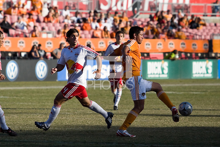 Houston Dynamo forward Brian Ching (25) passes the ball away from New York Red Bulls defedner Carlos Mendes (4).  New York Red Bulls defeated Houston Dynamo 3-0 for an aggregate  score of 4-1 over Houston Dynamo   at Robertson Stadium in Houston, TX on November 9, 2008 in the second leg of the Western Conference semifinals.  Photo by Wendy Larsen/isiphotos.com