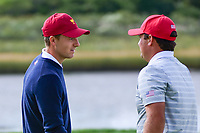 Jordan Spieth (USA) and Patrick Reed (USA) talk after Reed sunk his putt on 14 during round 3 Foursomes of the 2017 President's Cup, Liberty National Golf Club, Jersey City, New Jersey, USA. 9/30/2017.<br /> Picture: Golffile | Ken Murray<br /> <br /> All photo usage must carry mandatory copyright credit (&copy; Golffile | Ken Murray)