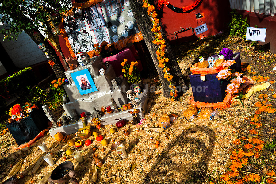 Food offerings, marigold flowers, death symbols and candles are placed at the altar of the dead (Altar de muertos), a religious site honoring the deceased, during the Day of the Dead celebration in Mexico City, Mexico, 28 October 2016. Skulls, skeletons and the other death symbols are used to adorn graves, altars and offerings during the Day of the Dead (Día de Muertos). A syncretic religious holiday, combining the death veneration rituals of the ancient Aztec culture with the Catholic practice, is celebrated throughout all Mexico. Based on the belief that the souls of the departed may come back to this world on that day, people gather at the gravesites in cemeteries, praying, drinking and playing music, to joyfully remember friends or family members who have died and to support their souls on the spiritual journey.