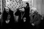 Woman drinking Holy water from well outside of house. Mrs Nora Arthurs, a Catholic Voice-Box, Seer and Mystic, in her home know as<br /> 'Mary's House&quot;, on Canvey Island, Essex UK conducting a prayer meeting. 1996