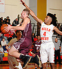 Josh Pismeny #10 of Deer Park, left, makes an acrobatic move inside the paint as Jeff Terry #4 of Half Hollow Hills West defends him during a Suffolk County League IV varsity boys basketball game at Half Hollow Hills West High School on Thursday, Dec. 21, 2017. Deer Park won by a score of 62-38.