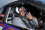 A'Lique Terry of the Wake Forest Demon Deacons gives a thumbs up sign as he prepares to take a ride in a NASCAR race car at the Charlotte Motor Speedway on December 26, 2017 in Concord, North Carolina.  (Brian Westerholt/Sports On Film)