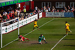 Visiting forward Javia Roberts celebrating scoring his side's third goal as Ilkeston Town (in red) host Walsall Wood in a Midland Football League premier division match at the New Manor Ground, Ilkeston. The home team were formed in 2017 taking the place of Ilkeston FC which had been wound up earlier that year. Watched by a crowd of 1587, their highest of the season, the match was top versus second, however, the visitors won 4-0 and replaced their hosts at the top of the division on goal difference with two matches to play