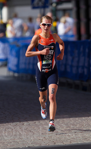 24 AUG 2013 - STOCKHOLM, SWE - Rachel Klamer (NED) of the Netherlands runs through the streets of Gamla Stan the old part of Stockholm, Sweden during the elite women's ITU 2013 World Triathlon Series round (PHOTO COPYRIGHT © 2013 NIGEL FARROW, ALL RIGHTS RESERVED)
