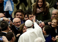 Papa Francesco accarezza un bambino all'arrivo all'udienza generale del mercoledi' in aula Paolo VI in Vaticano, 4 gennaio 2017.<br /> Pope Francis caresses a child as he arrives to lead  his weekly general audience in Paul VI Hall at the Vatican,on January 4, 2017.<br /> UPDATE IMAGES PRESS/Isabella Bonotto<br /> <br /> STRICTLY ONLY FOR EDITORIAL USE