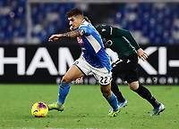 1st December 2019; Stadio San Paolo, Naples, Campania, Italy; Serie A Football, Napoli versus Bologna; Giovanni Di Lorenzo of Napoli wins the ball to clear his box for Napoli - Editorial Use
