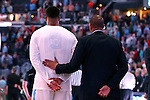 11 March 2016: UNC assistant coach Hubert Davis (right) puts a steadying hand on the back of Kennedy Meeks (3) during the national anthem. The University of North Carolina Tar Heels played the University of Notre Dame Fighting Irish at the Verizon Center in Washington, DC in the Atlantic Coast Conference Men's Basketball Tournament semifinal and a 2015-16 NCAA Division I Men's Basketball game. UNC won the game 78-47.