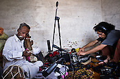 66-year-old Manganiyar artist, Lakha Khan plays the Sarangi while Ankur Malhotra of Amarrass records in Khan's house in Raneri village of Jodhpur district in Rajasthan, India. Photo: Sanjit Das/Panos