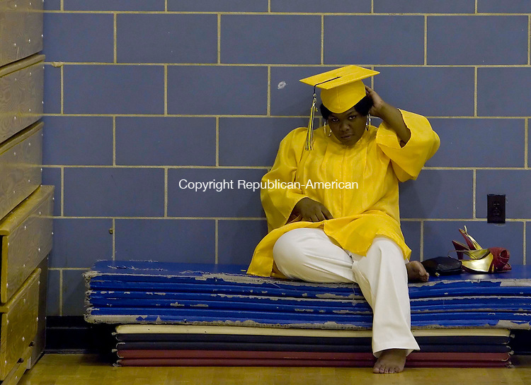 WATERBURY, CT --JUNE 16, 2008-061608JS03-Kennedy High School graduate Shawnese Mercer sits and relaxes as she waits in the gym for the start of Monday's commencement exercises. <br /> Jim Shannon/Republican-American