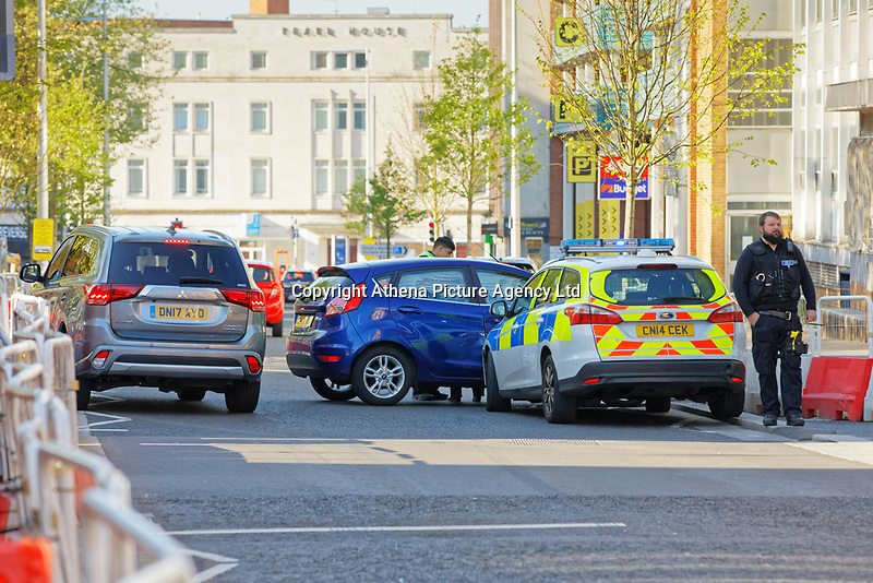 A Ford Focus police car has collided with a blue Ford Fiesta in the corner of Orchard Street and Pleasant Street, in the city centre of Swansea, Wales, UK. Sunday 05 May 2019