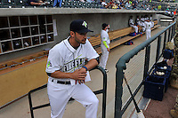 Manager Jose Leger (19) of the Columbia Fireflies watches the ceremonies before the home opener against the Greenville Drive on Thursday, April 14, 2016, their first day at the new Spirit Communications Park in Columbia, South Carolina. The Mets affiliate moved to Columbia this year from Savannah. Columbia won, 4-1. (Tom Priddy/Four Seam Images)