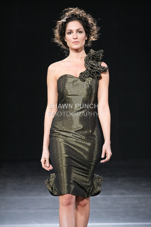 Models walk runway in a Suzie Turner Fall 2011 outfit, during Couture Fashion Week Fall 2011 in New York.